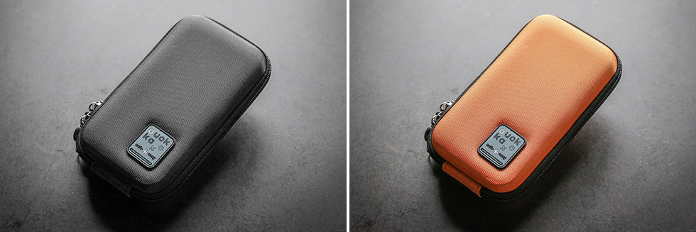 La pochette pour téléphone portable Quokka existe en noir et en orange
